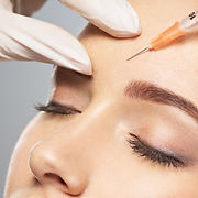 Woman getting cosmetic injection of boto