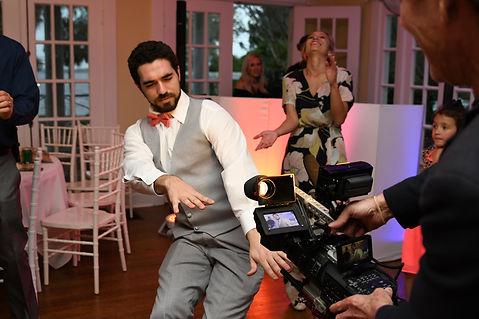 Byron shooting at wedding.JPG