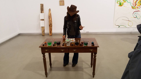 OBJECTS USED DURING THE PERFORMANCE: LIVE DRAWING/ WOODEN TABLE, ALUMINUM STEP LADDER, WOODEN PIECES, LIQUID WATER COLOR, WATER IN GLASSES, SADDLE; RESULT DRAWINGS 3X20/30CM