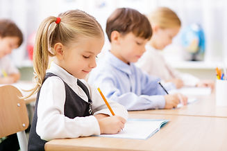 Collective work. Little pupils are all busy writing in their copybooks..jpg