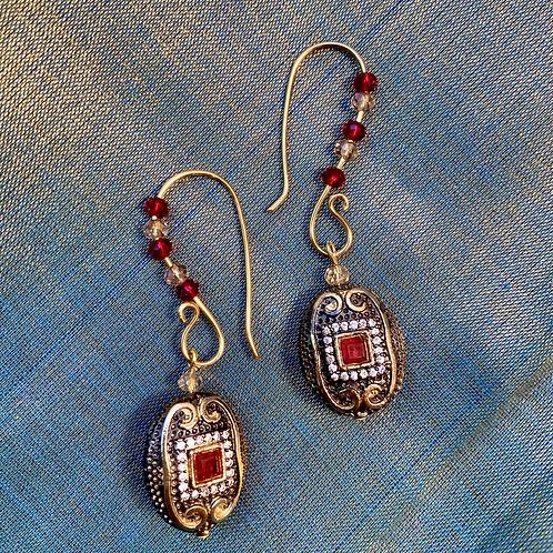 Long single charm earrings gold