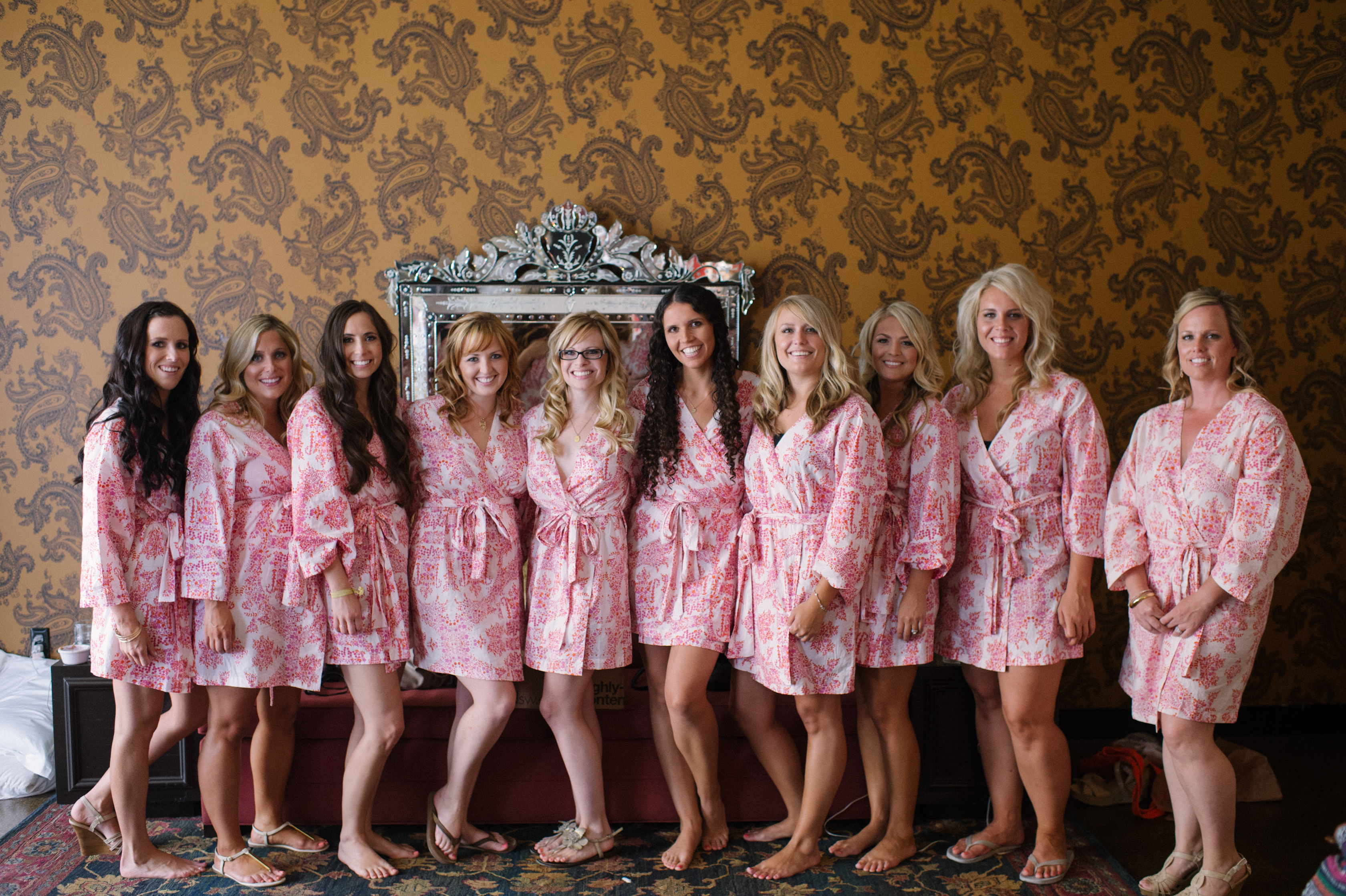 The bridal party in matching robes