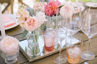 Flower Design for the wedding with pink flowers and vintage mirrors and glasses