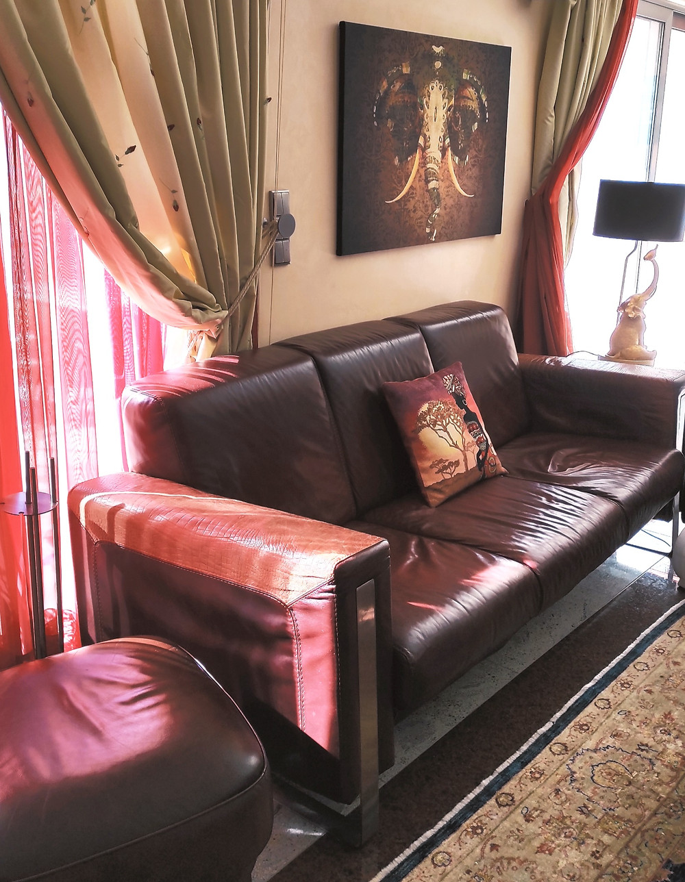 livingroom-home-interior-brown-sofa-couch-pillowswall-painting-red-decor