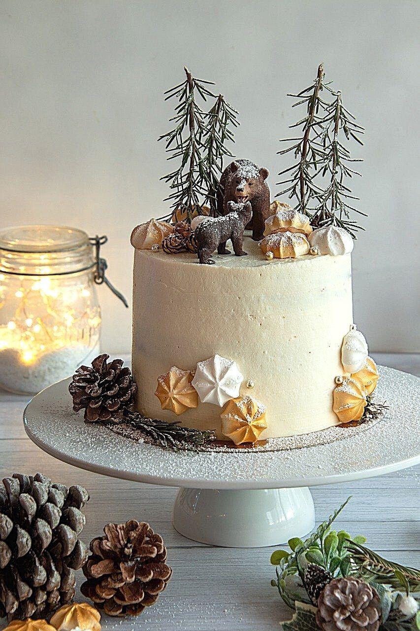 white-christmas-cake-winter-pinecones-fir-christmas-table-royalpie