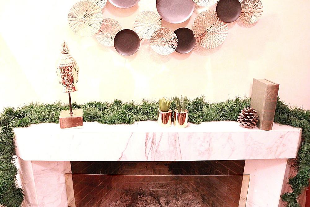 home-interior-winter-decoration-details-buddha-book-pinecone-fireplace-cozy