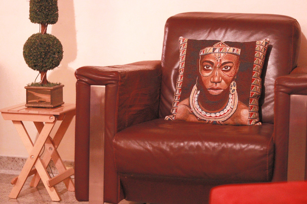brown-leather-armchair-purple-pillow-african-style-interior-livingroom-home-decor-tree-