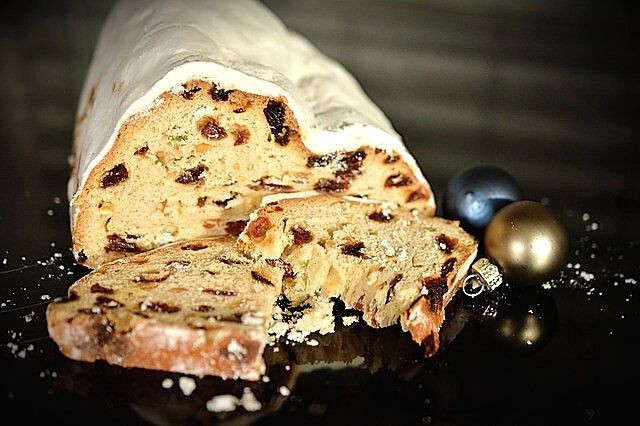 white-icing-sweet-bread-with-dried-grapes-and-fruits-christmas-cake-Royal-cake-christmas-table