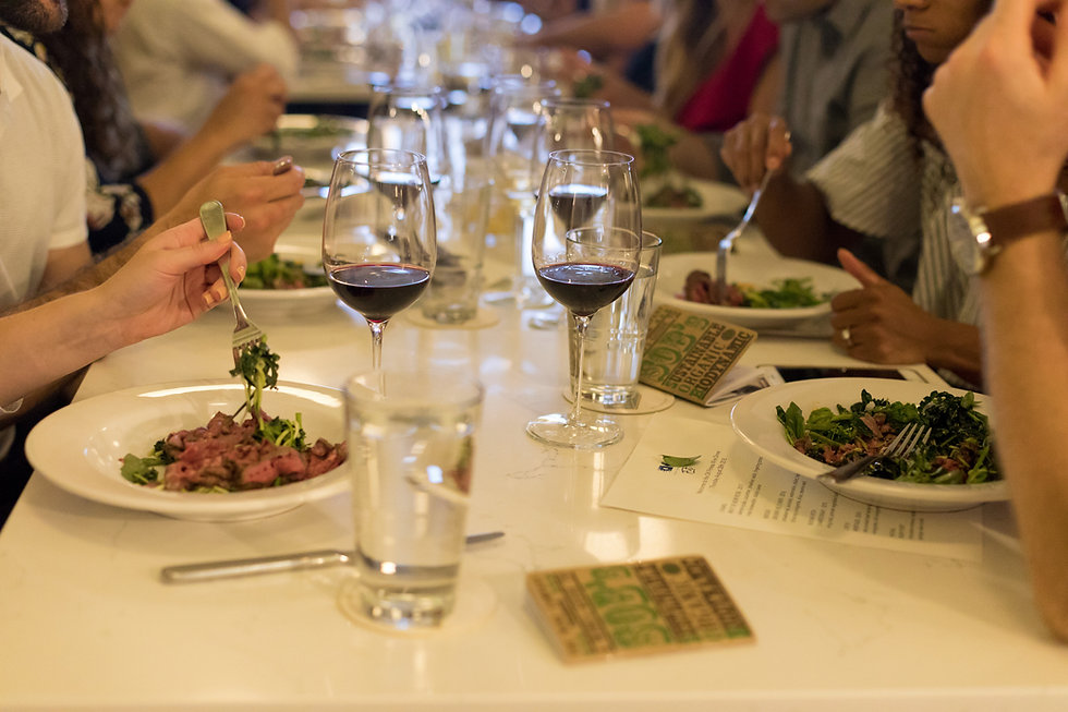 large group dining with a pre-fixed meal paired with wine