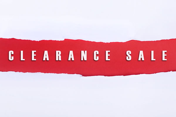 Torn paper with a CLEARANCE SALE word on