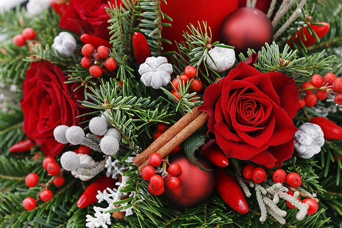 Christmas decoration with red roses, fir