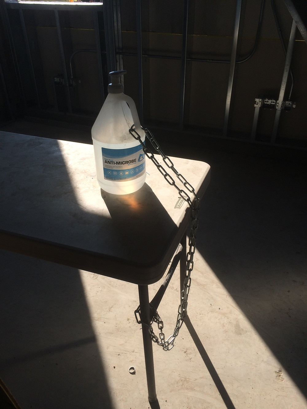Hand sanitizer chained to a table