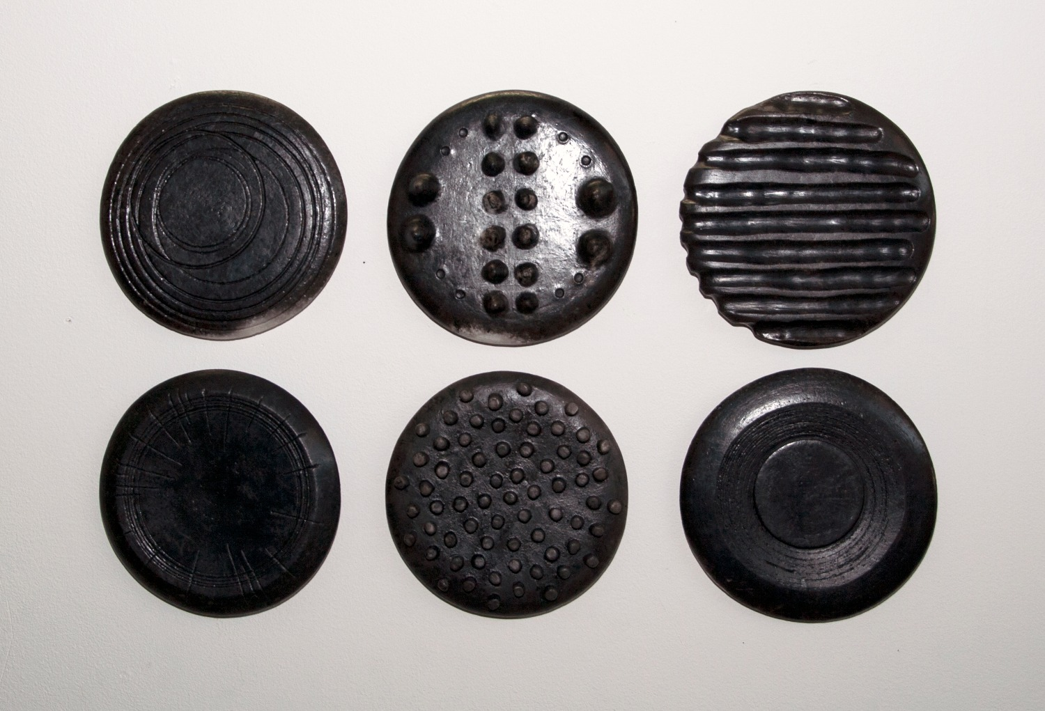small carbonised discs