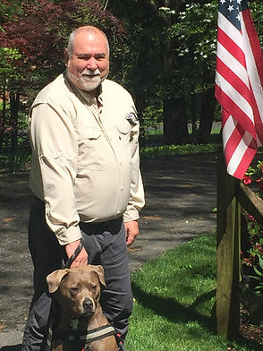 steele-with-flag-and-dog-scaled.jpg