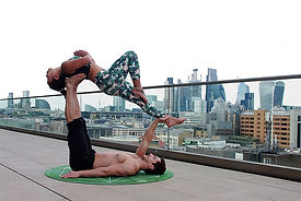 man-lying-down-on-mat-while-lifting-woma