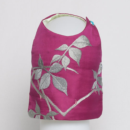 Magenta silk vest with embroidered leaves and rosebud