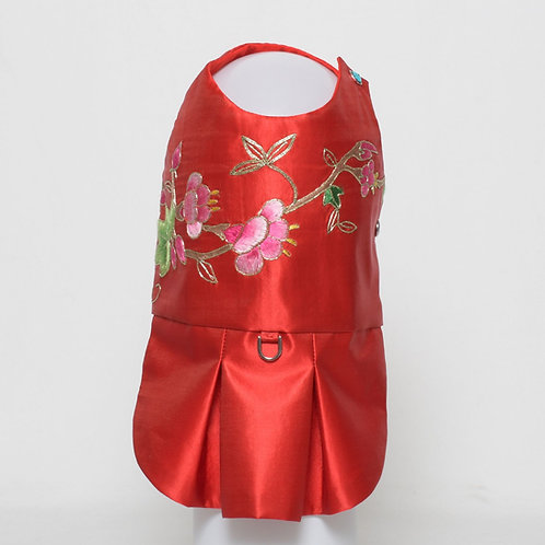 Red silk dress with embroidered flowers and ivy