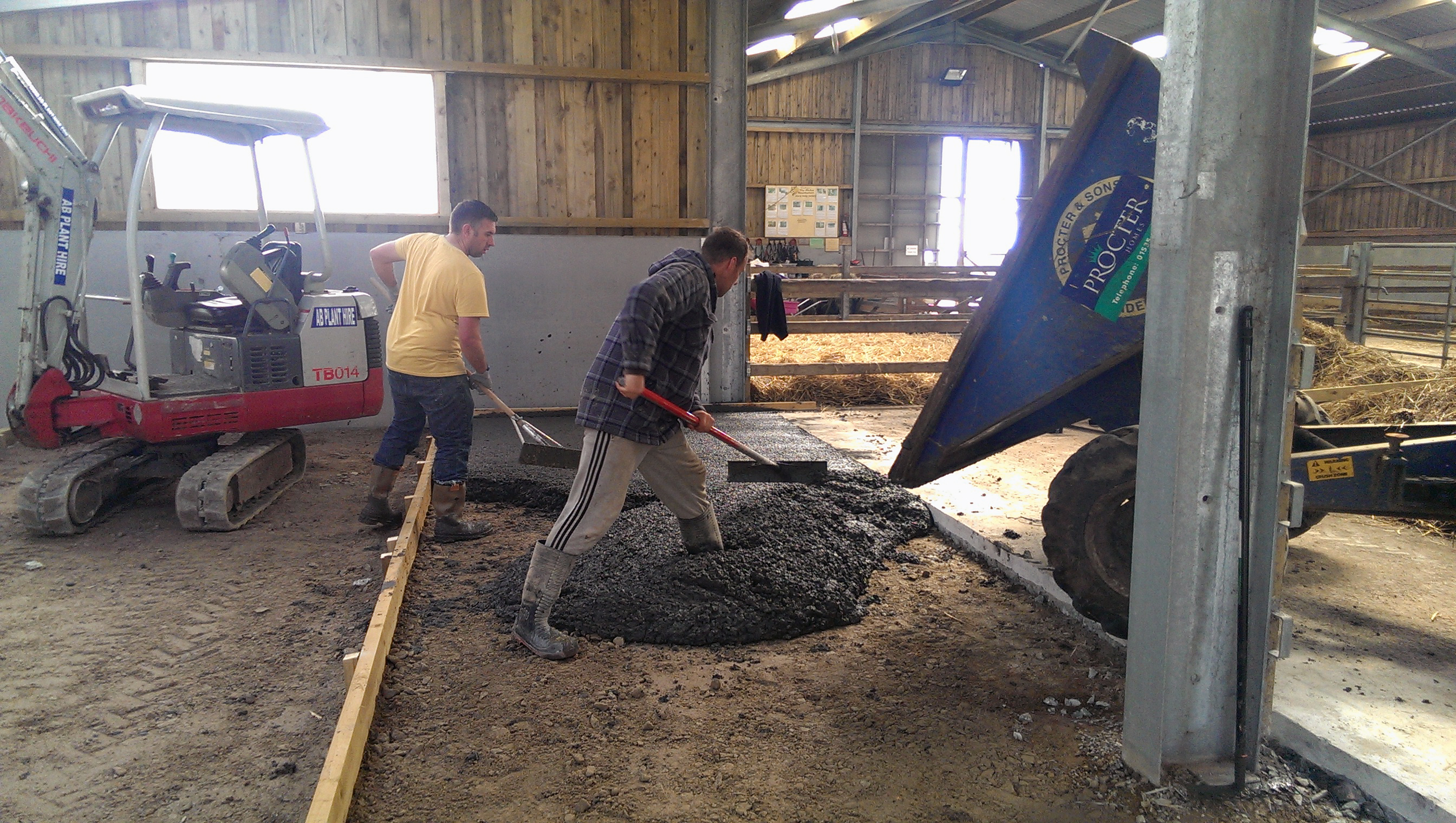 men working on concrete slab