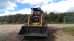 woman driving a skid steer