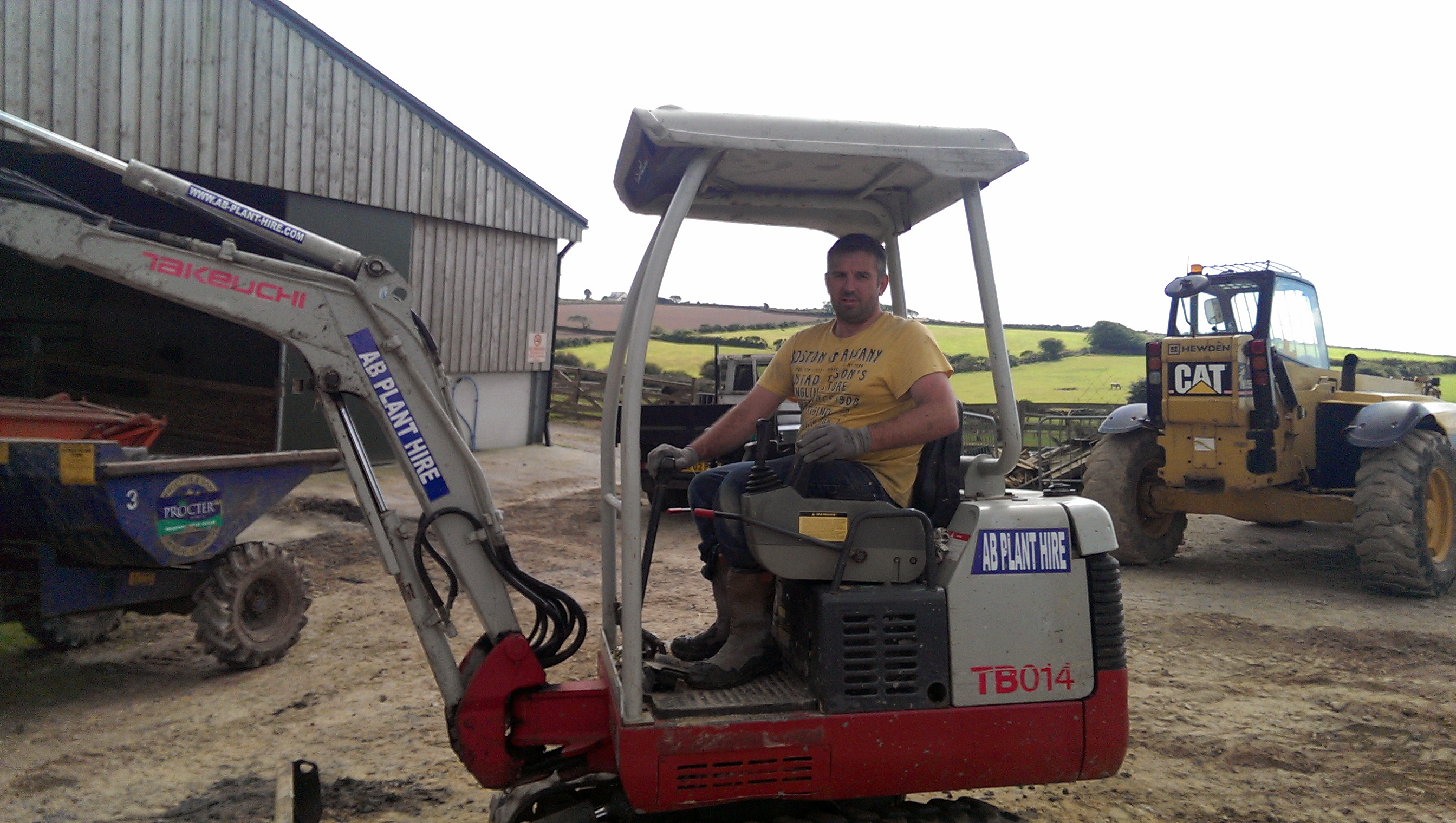 man sitting in a mini digger