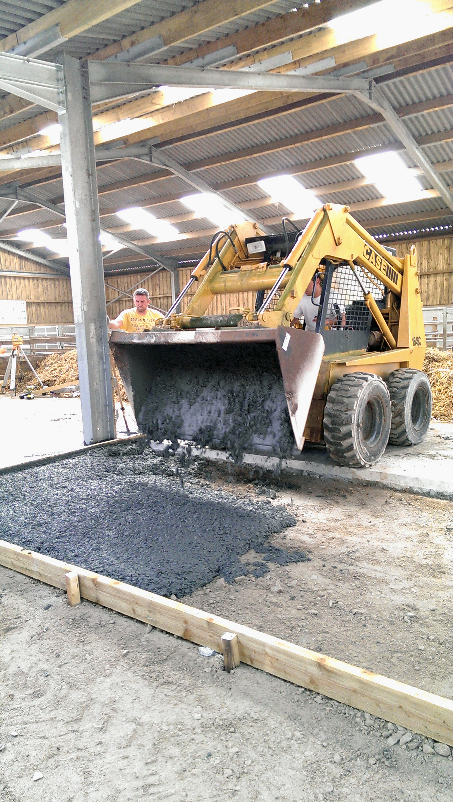 skid steer paying concrete slab