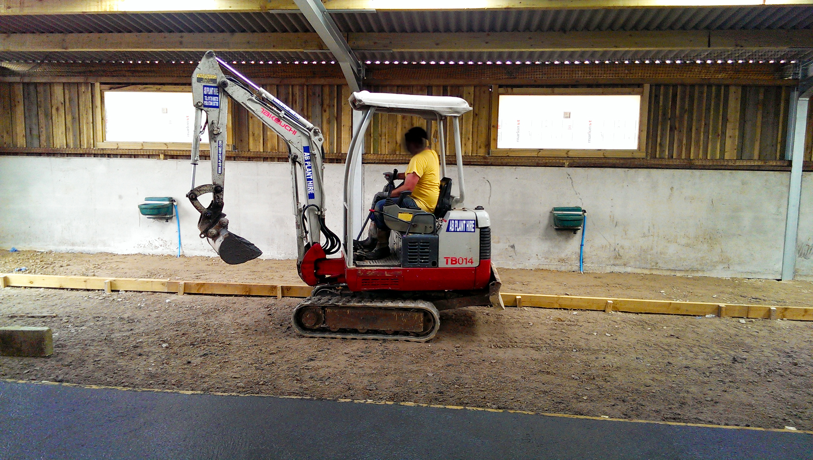 man driving a mini digger