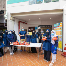 Our team pose for a shot whilst giving out free Nasi Briyani meals!