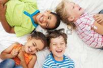 42247759-overhead-view-of-four-children-