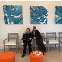 36x36 acrylic pour paintings in an optometrist office