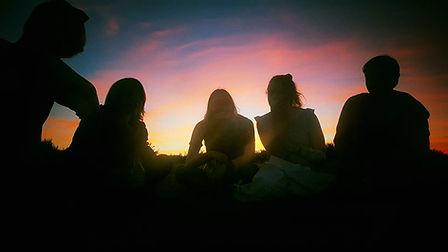 Teenagers enjoying the Sunset