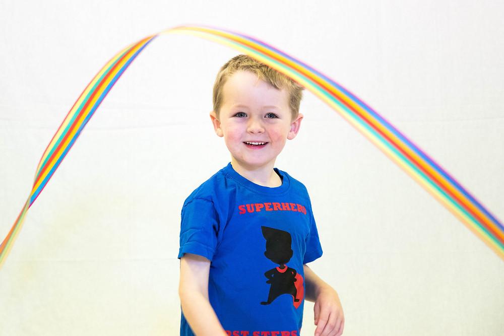 Superhero child dancing