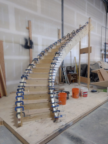 Curved Staircase with Handrail and Lots of Clamps