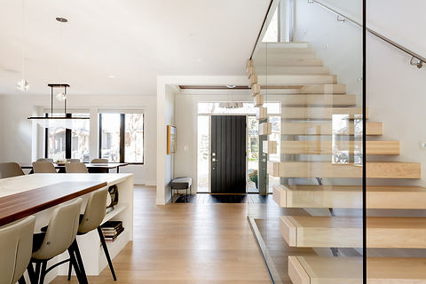 White Oak Cantilever Stair with Curtain Glass