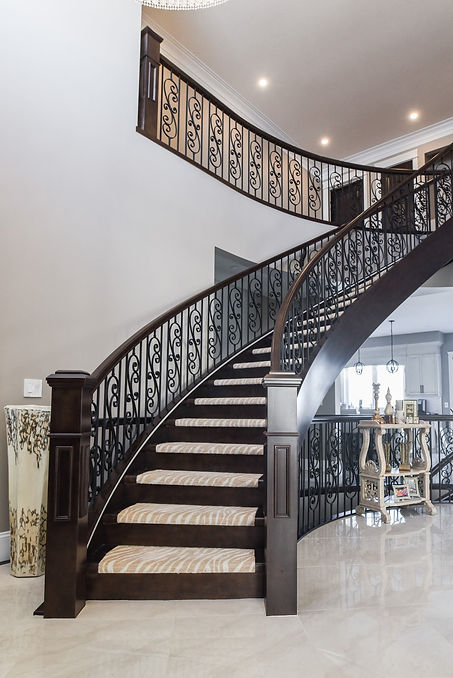 Circular Closed Rise Stairs with Carpet and Custom Newel Posts