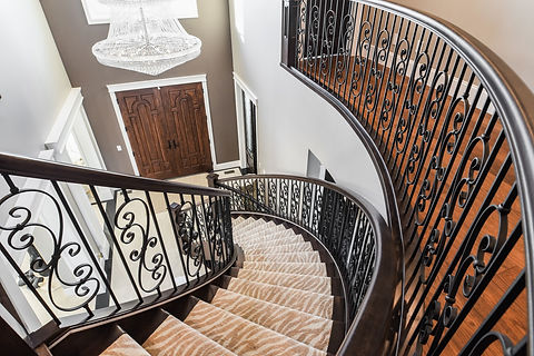 Circular Stairs with Handrail and Scroll Spindles