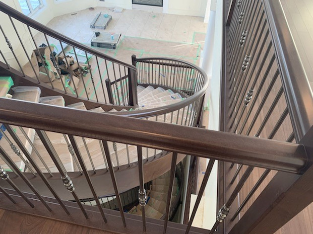 Housed Open Rise Curved Staircase with Butcher Block Treads_4