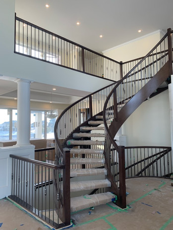 Housed Open Rise Curved Staircase with Butcher Block Treads_5