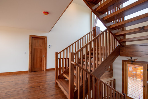 Housed Open Rise Stairs with Wood Spindles and Fully Cladd Apron_4