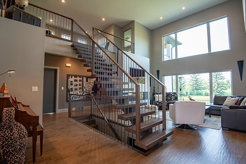 Steel Mono Stringer Staircase with Stained Maple Treads, Maple Handrail, and Metal Spindles