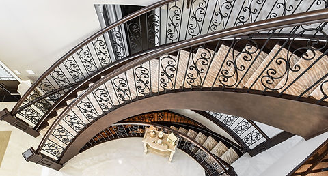 Two Circular Stairs with Handrail and Scroll Spindles