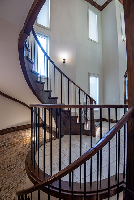 Circular Stairs in Medieval Walnut with Custom Handrail and Metal Spindles