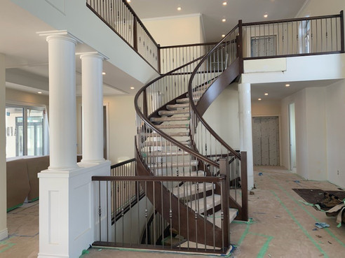 Housed Open Rise Curved Staircase with Butcher Block Treads_6
