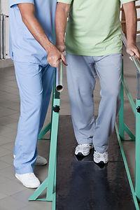 Senior man having ambulatory therapy with his therapist.jpg