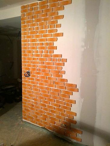 Chantier réalisation mur en briques