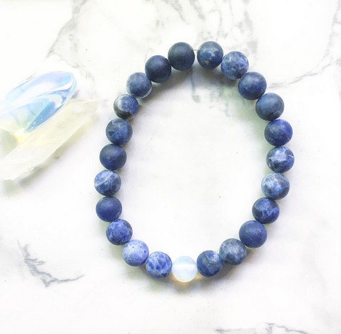 Elastic Matte Sodalite Bracelet With Opalite Accent Bead Measures At About 7 5