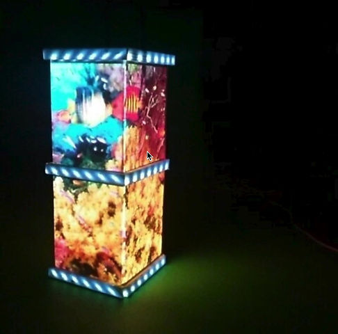 A projection mapped fish tank column at The Zoo Studios.
