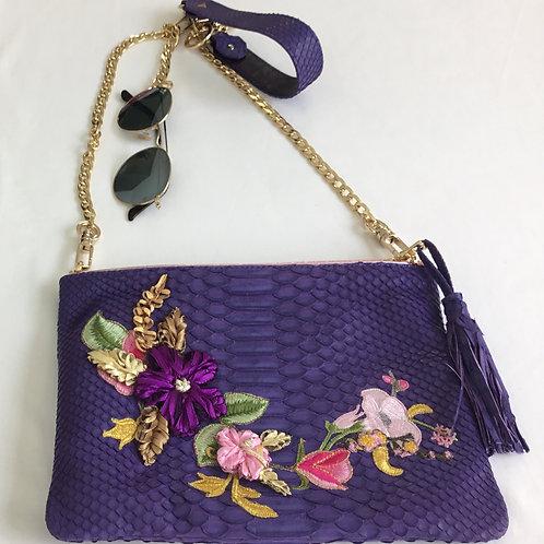 Violet snakeskin handbag