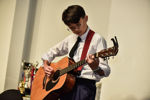 Clyde Lee performing in Faith Anglican Academy's Instrumental Ensemble