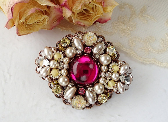 Dark pink and yellow rhinestone brooch