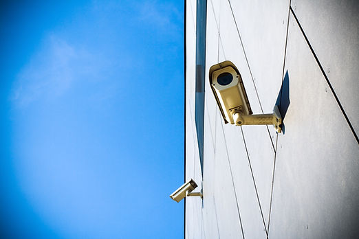 security-camera-over-blue-sky-PHW2B99.jp